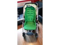 Mamas & papas solar pushchair green with printed hood.