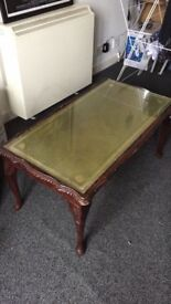 Wooden Coffee table with glass top and gold details