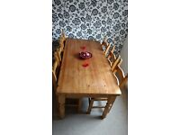 Solid pine farmhouse dining table with cutlery drawer and 6 chairs