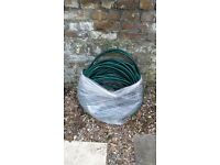 A LARGE HOSE FOR YOUR GARDENING