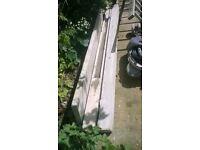 2 posts and concrete plinth