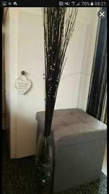 Black decorative spray in glasd vase with beads