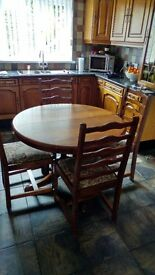 Solid oak dining table n 4 high back chairs