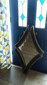 Bronze mirror and coatstand for hall, from Alexanders