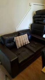 Brown leather sofa 2 seater and two 1 seater chairs like new.