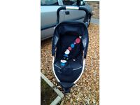 Verve black and silver three wheeled pushchair