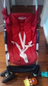 Graco pushchair for sale. Red
