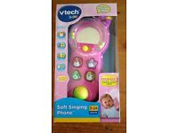Vtech soft touch pink singing phone.