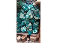 Netted Sacks of Hardwood Logs