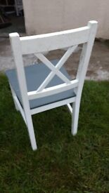 4 white and grey chairs