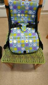 Munchkin portable travel/ high chair with storage