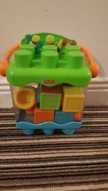 Fisher price stacking pop up blocks with container.