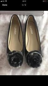 Brand new black flats in box size 7