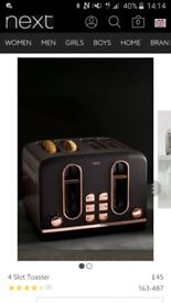 Toaster black and copper...brand new in box