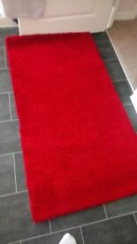 Red rug piled. From. Ikea