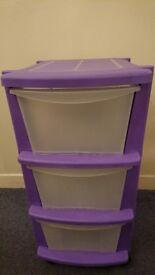 3 purple storage drawers on castors