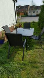 Black Smoked Glass and Metal Patio Table and 6 chairs