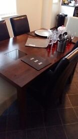 Quality Dining table and 6 chairs.