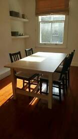 Extendible wooden dinner table 4-6 people.