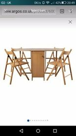 BRAND-NEW butterfly dinning table and chairs oak effect and BRAND-NEW chair pads x