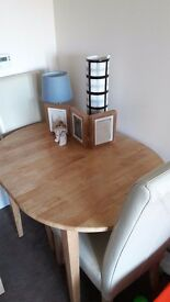 Extendable oak dinning table and two cream leather chairs