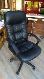 Large comfy computer swivel chair in black leather effect