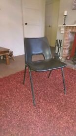 40 black plastic stacking chairs . £2 EACH