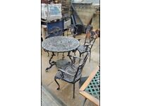 Lovely solid cast iron table and chairs