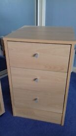 Light coloured bedside drawers and small shelf unit
