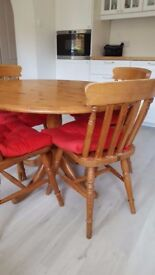 Round pine dining table and four chairs. Marks and Spencers.