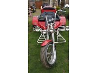 Rewaco HS4 3 seater trike in red glimmer