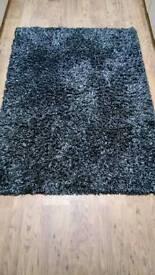 Black and grey shaggy rug