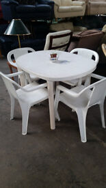 White plastic table & 4 chairs