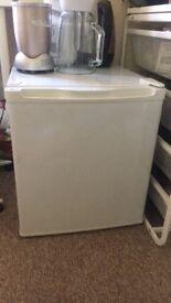 White mini fridge