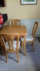 "Solid Cherry Wood Extendable Table and 4 Chairs 29"" h x 31"" w x 31"" d"