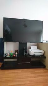 TV STAND . TV NOT INCLUDED . £100 ono.