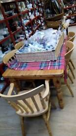 Pine table with 6 chairs 2 are carvers