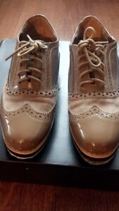 Pair of beige Oxford shoes