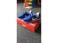 Brand new never worn boys Nike trainers