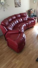 Red leather sofa reclining seats and storage footstool