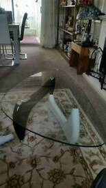 Stylish curved glass Coffee table, with gloss finish and chrome feet.