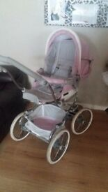 Bebecar stylo magic pram powder pink comes with rain covers cosy toes and carrie cot