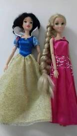 Disney store dolls Snow white and Rapunzel