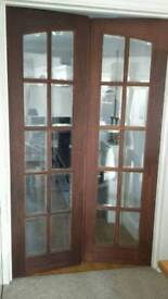 Solid wood internal glazed double doors. Bevelled glass