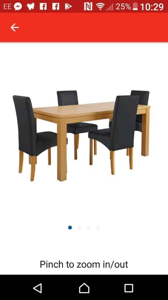 Table and 4 black chairs