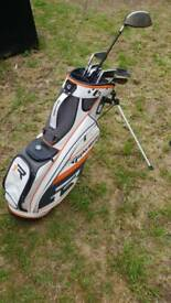 Taylor made golf bag and driver with selection of clubs