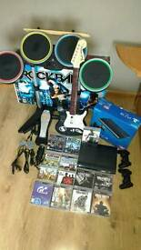PS3 superslim console, 13 games, 2 controller and Rock band 2