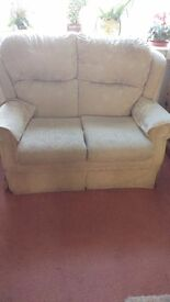 Cream two seater settee and two matching chairs.