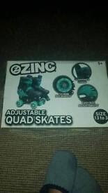 Zinc adjustable roller skates NEW