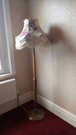 Vintage walnut standard lamp with floral lampshade. In working order. Very good condition.